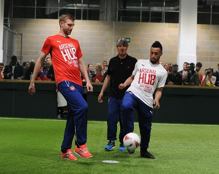 LONDON, ENGLAND - MAY 08:  (L-R) Arsenal's Per Mertesacker and Francis Coquelin kick off the first official match at the Arsenal Community Hub at Emirates Stadium on May 8, 2015 in London, England.  (Photo by Stuart MacFarlane/Arsenal FC via Getty Images) *** Local Caption *** Francis Coquelin;Per Mertesacker
